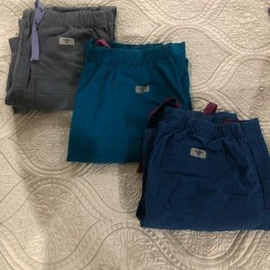 Med couture scrubs 10 dollars a piece